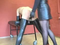 Tranny dominatrix takes her whip