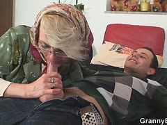 Horny granny satisfies young cock
