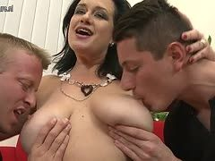 Granny takes two young cocks