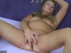 Big granny is masturbating
