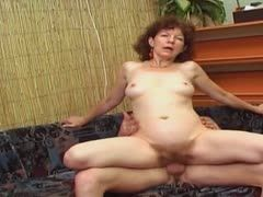 Hairy milf spoiled by a young cock