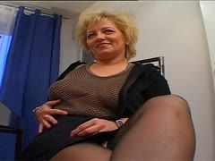 Fat blonde granny lets him fuck her tits in the office
