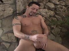 Tattooed gay is wanking his dick
