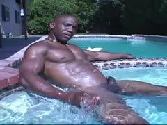 Gay Negro wanks his dick poolside
