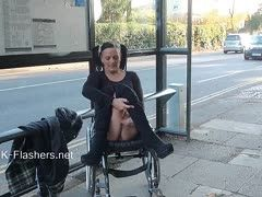 Nudist in wheelchair shows everything outdoors