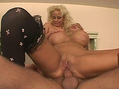 Two milfs with huge tits share a hard dick