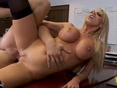 Hot busty Nikki Benz gets a fuck in the office