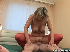 Granny in red nylons rides young cock