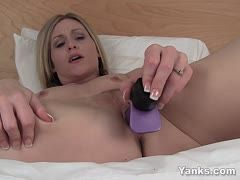 Hot babe fucks herself with purple vibrator