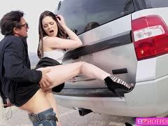 Young slut in high heels goes wild while fucking in the car