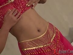 Naked belly dancer gets dressed