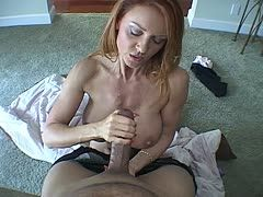 Red-haired milf wanks the big cock
