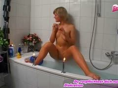 German blonde nylon girl masturbates in the bathtub