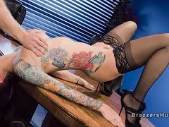 Tattooed porn bitch is fucked in the office