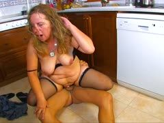 Fat granny is banged in the kitchen