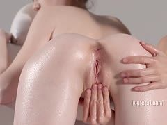 Girl is massaged to an orgasm by a lesbian