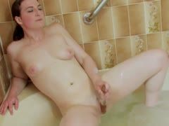 Hot bath with a glass dildo