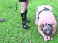 Dominatrix takes her fat slave dog out for a walk