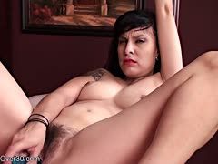Hairy black-haired dildoes herself